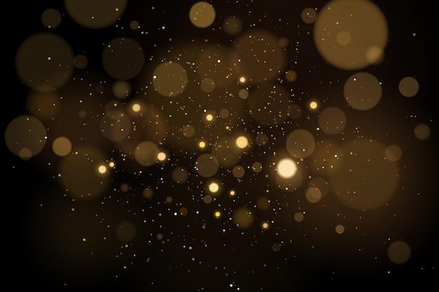 Resumen resplandores efecto bokeh con brillos sobre un fondo negro. luces de navidad.