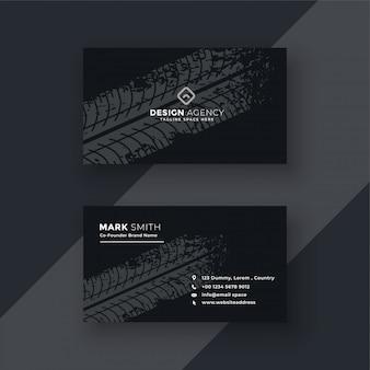 Resumen tarjeta de visita oscura con marca de neumático