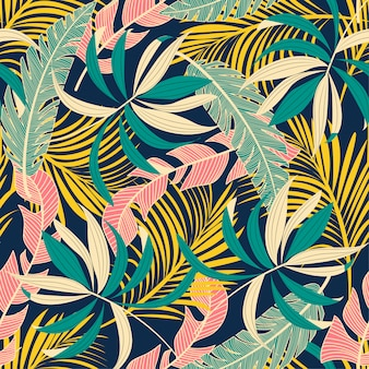 Resumen de verano de patrones sin fisuras con coloridas hojas tropicales y plantas