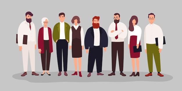 Retrato de grupo de lindos oficinistas felices, gerentes o empleados de pie juntos.