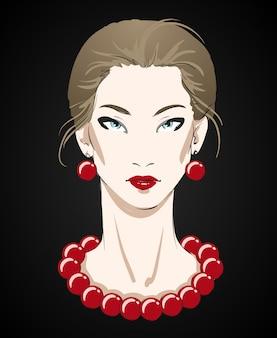 Retrato hermoso de la mujer joven con el collar rojo