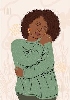 Retrato de mujer afroamericana agradable abrazando a sí misma. uno mismo feliz y positivo, sonriendo confiado.