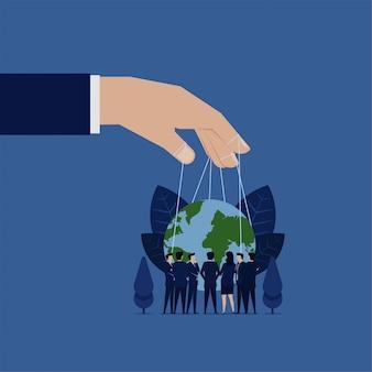 Reunión de negocios para gobernar el globo del asimiento de la mano del mundo con títere de cuerda.