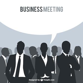 Reunión de negocios con siluetas vector gratuito