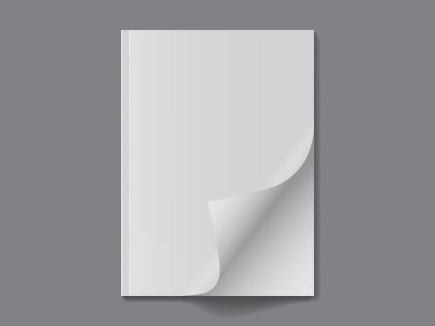 Revista blanca abierta sobre fondo oscuro
