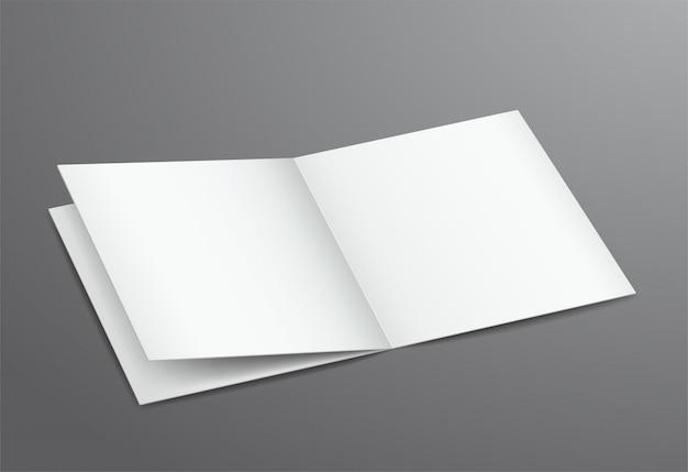 Revista de folleto abierto blanco en blanco