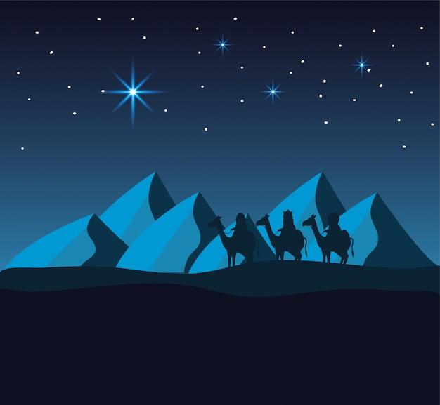 Reyes magos montan camellos en el desierto con montañas