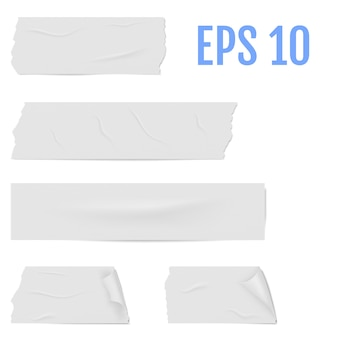 Rodajas de una cinta adhesiva blanca con sombra y arrugas.