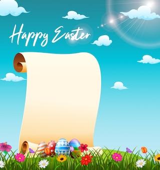 Rollo de papel en blanco en el campo de hierba con huevos de pascua decorados