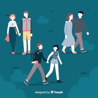 Románticas parejas jóvenes caminando juntas