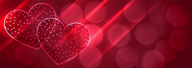 Romántico dos corazones brillantes bokeh banner background