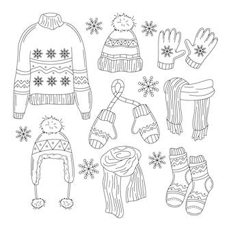 Ropa de invierno y elementos esenciales dibujados a mano.