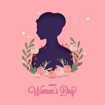 Rostro femenino cortado en papel decorado con flores sobre fondo rosa