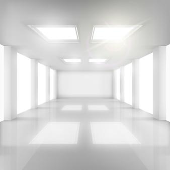 Sala blanca con ventanas en paredes y techo.