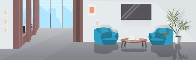 Sala de estar con sillones, mesa de centro y televisión, boceto interior de oficina moderna