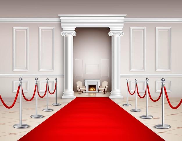 Sala de estilo victoriano con alfombra roja, barreras plateadas, sillones y chimenea.