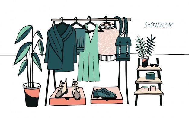 Sala de exposición de ilustraciones. perchero con ropa, bolsos, cajas y zapatos, moda, estilo moderno.