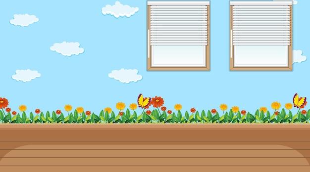 Sala de jardín de infantes vacía con cielo y papel tapiz de campo de flores