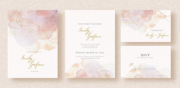 Salpicaduras abstractas con forma dorada en la tarjeta de invitación de boda