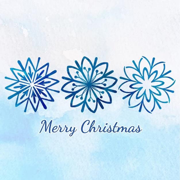 Saludo de feliz navidad con copo de nieve de acuarela