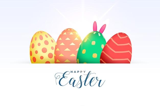 Saludo de huevos coloridos de pascua feliz con orejas de conejo de conejito