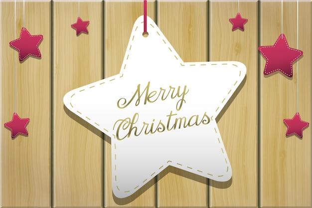 Saludo navideño con estrellas sobre tablas de madera.