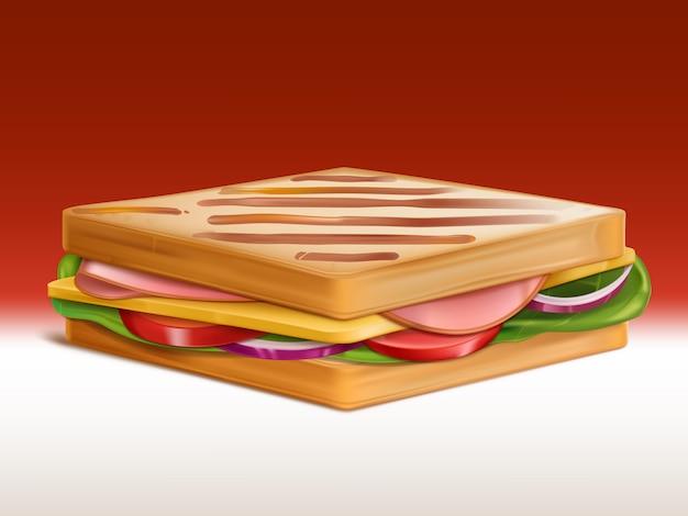 Sándwich de jamón, queso, tomate, cebolla y ensalada entre dos trozos de pan tostado en pan tostado.