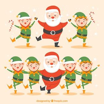 Santa claus y elfos bailando