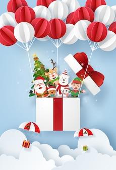 Santa claus y lindo personaje en una caja de regalo con globo en el cielo