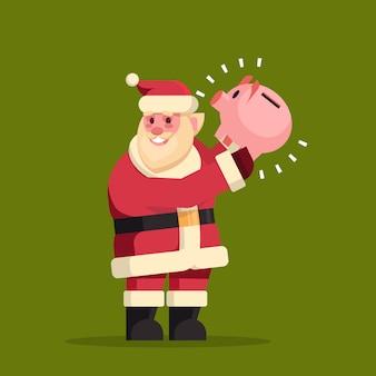 Santa claus mantenga hucha ahorros de dinero para navidad