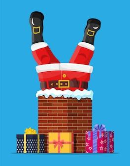Santa claus con regalos pegados en la chimenea de la casa
