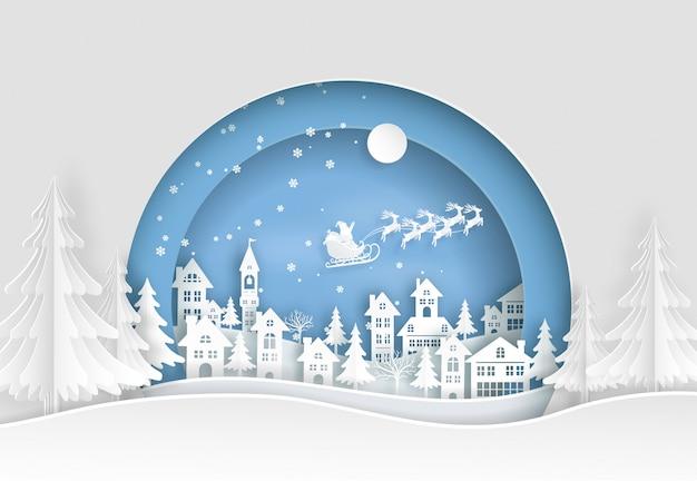 Santa claus vuela sobre la ciudad y la tierra con nieve
