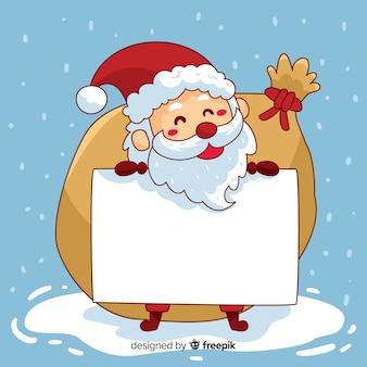Santa dibujado a mano sosteniendo cartel vacío