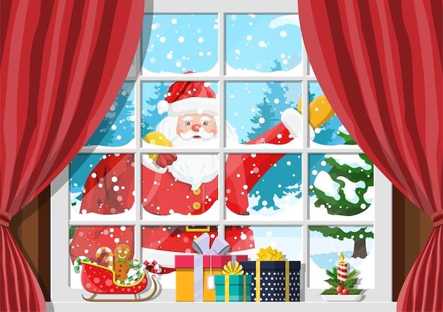Santa en la ventana de la habitación con árbol de navidad y regalos