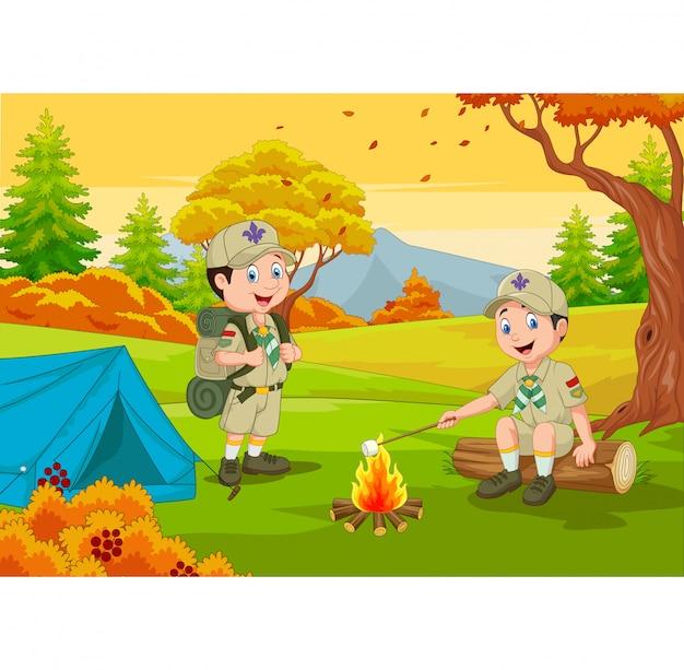 Scout de dibujos animados con carpa y fogata