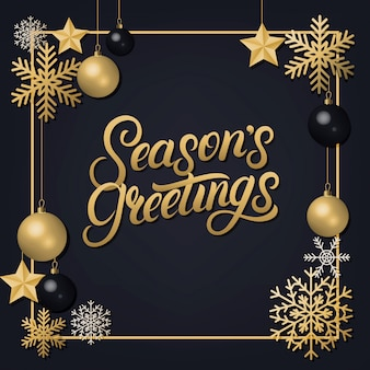 Seasons greetings letras escritas a mano con adornos de decoración dorada.
