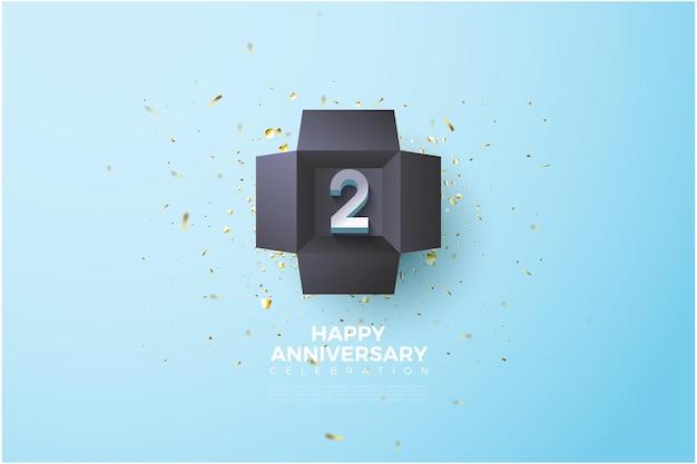 Segundo aniversario con ilustración de número en una caja de regalo negra.