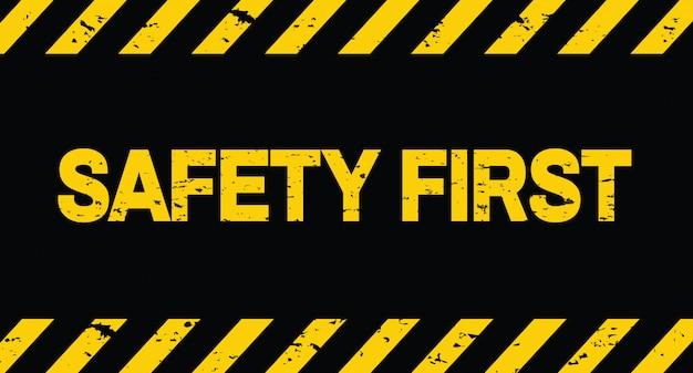 Seguridad primero. línea negra y amarilla a rayas. en construcción