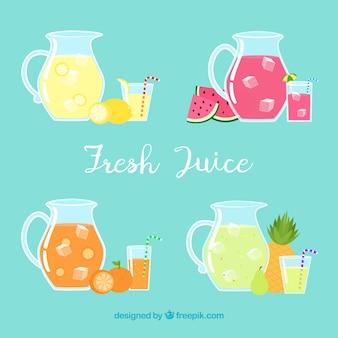 Selección de cuatro jarras con zumos de fruta
