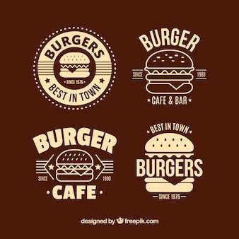 Selección plana de cuatro logos de hamburguesa decorativos