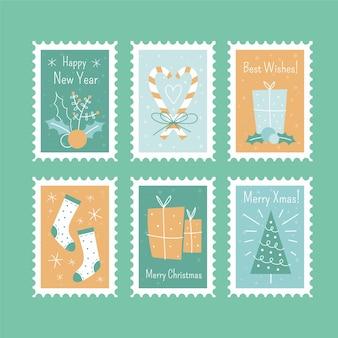 Sellos postales de navidad conjunto dibujado a mano aislado