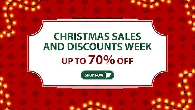 Semana de rebajas y descuentos navideños hasta 70% de descuento en pancarta roja con marco blanco vintage
