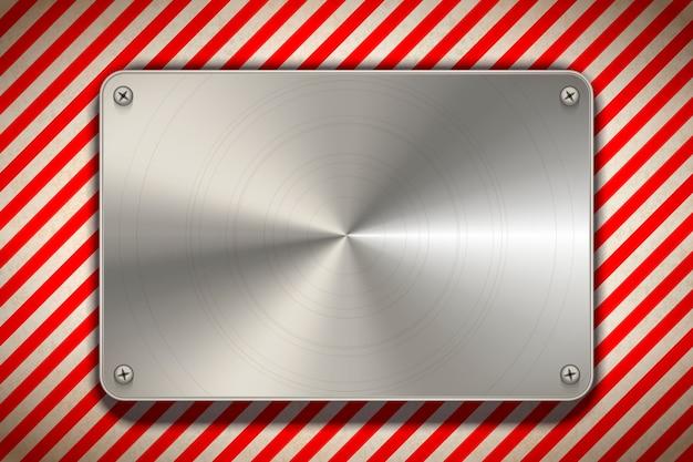Señal de advertencia de rayas rojas y blancas con placa de metal pulido en blanco, fondo industrial