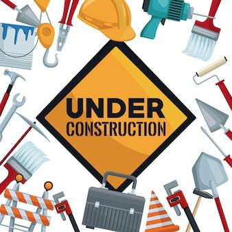 Señal con texto en construcción y borde de herramientas