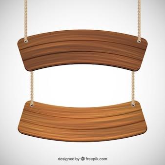 Señales de madera colgando en una cuerda