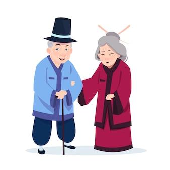 Senior pareja asiática vestida con trajes tradicionales