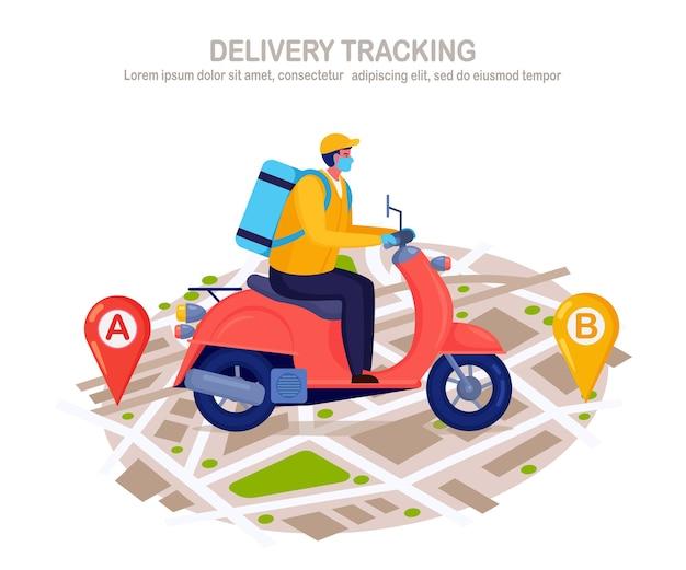 Servicio gratuito de entrega rápida en scooter. el mensajero entrega el pedido de comida. el hombre en una mascarilla de respiración con un paquete viaja en un mapa. prevención del coronovirus, covid-19