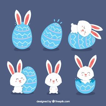 Set de conejos con huevo de día de pascua en estilo plano