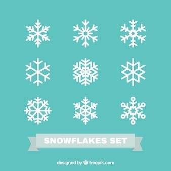 Set de copos de nieve en diseño plano