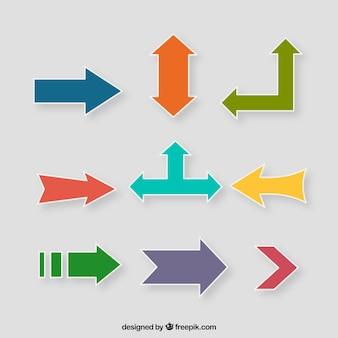 Set de pegatinas de flechas de colores en diseño plano